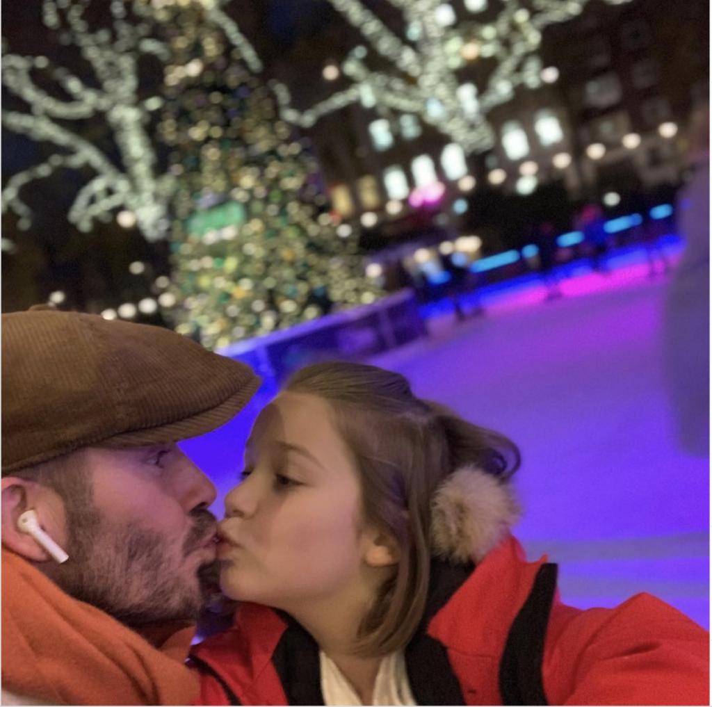 David Beckham kissing daughter on the lips.