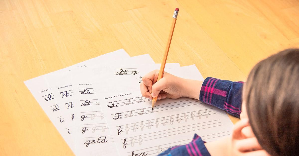 child writing cursive
