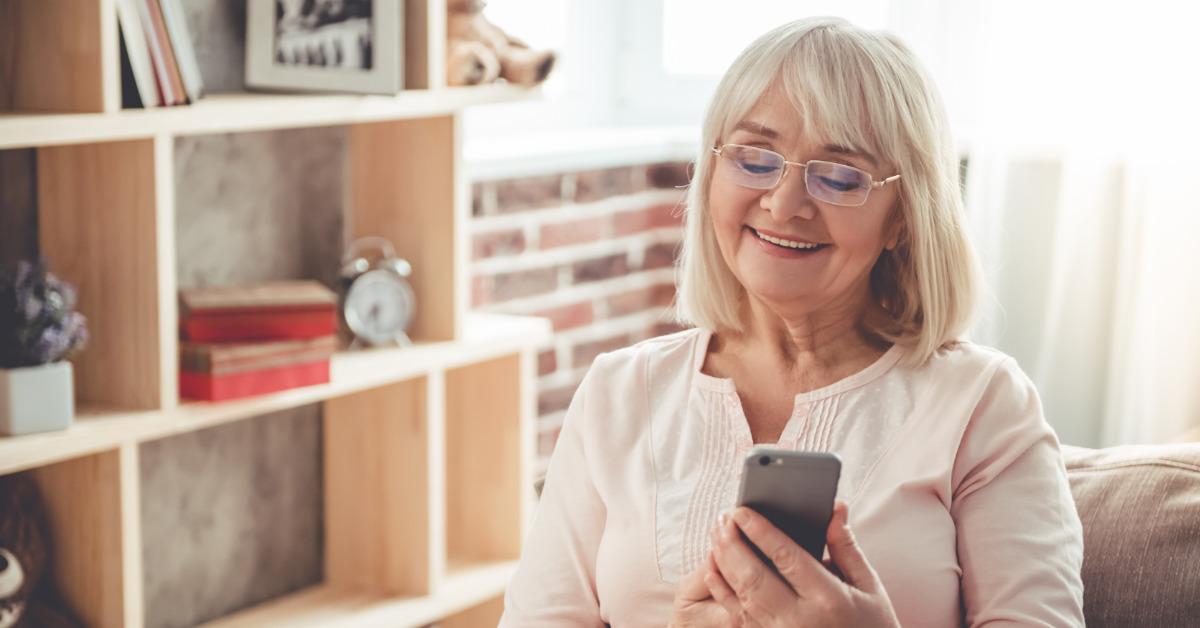 elderly woman looking at her smart phone