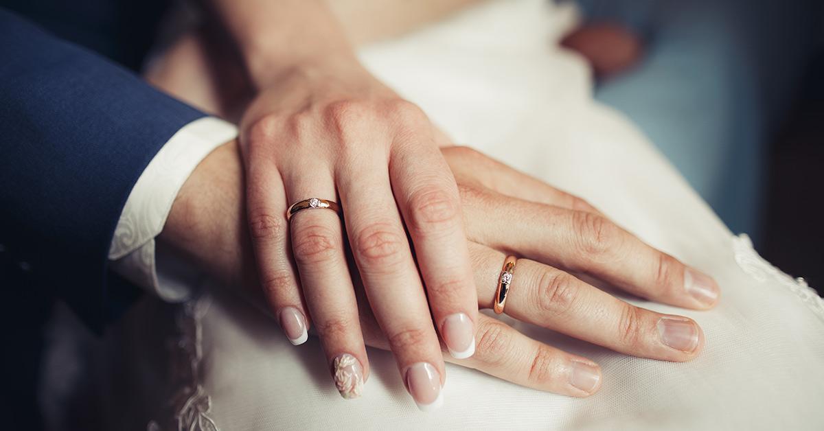 couple wearing wedding bands