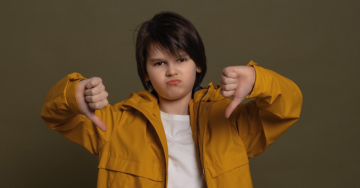 young tween boy giving thumbs down