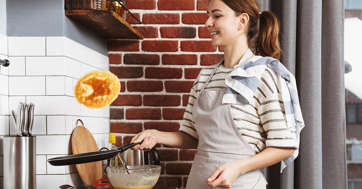 woman flipping pancakes